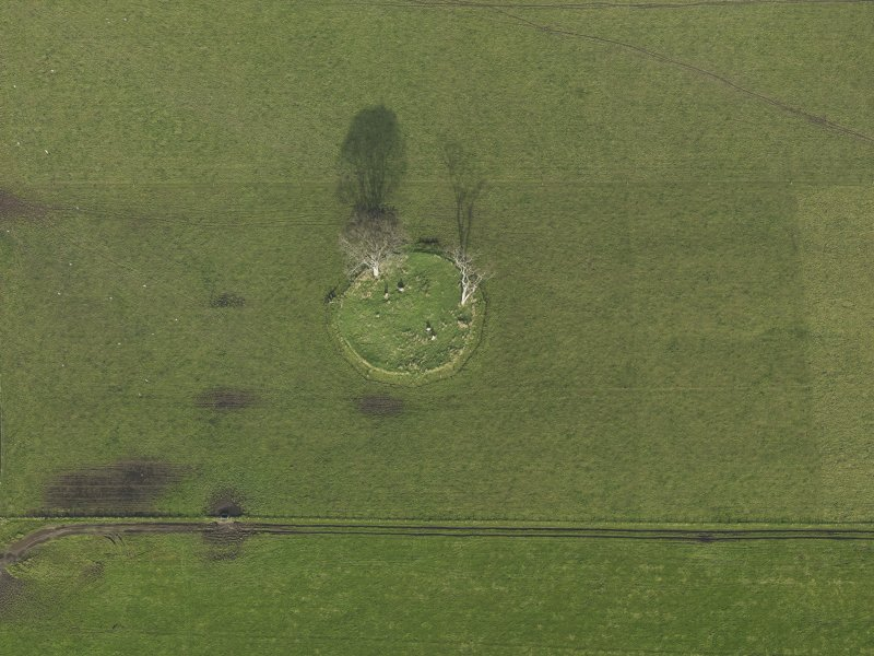 Oblique aerial view centred on the stone circle, taken from the SW.