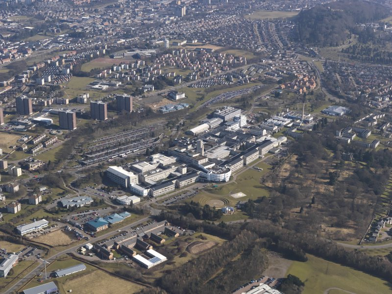 General oblique aerial view centred on the hospital, taken from the SW.