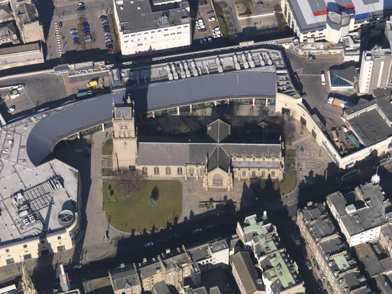 Oblique aerial view centred on the church, taken from the SSE.