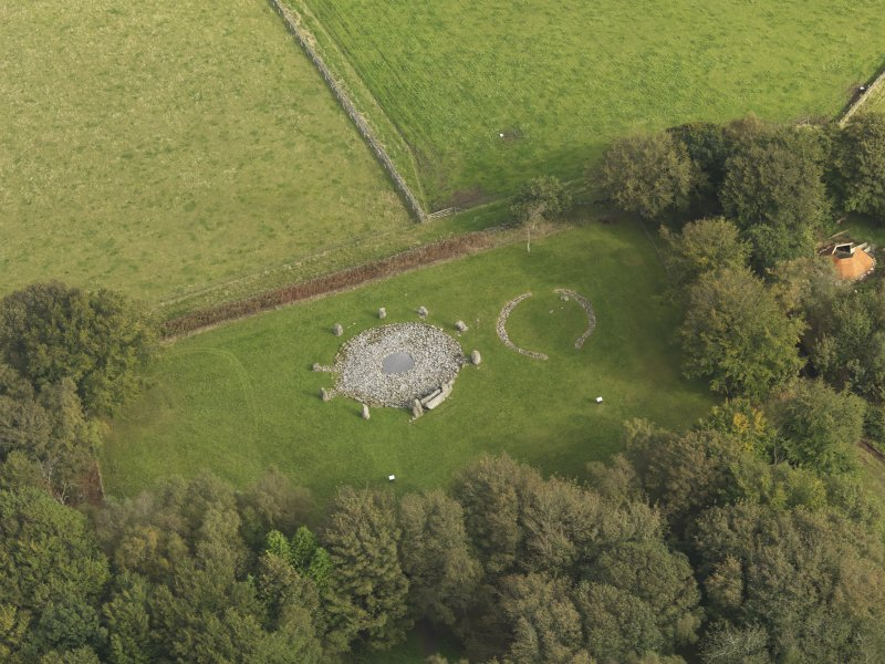 Oblique aerial view of the remains of the recumbent stone circle and enclosed cremation cemetery at Loanhead of Daviot, taken from the SW.
