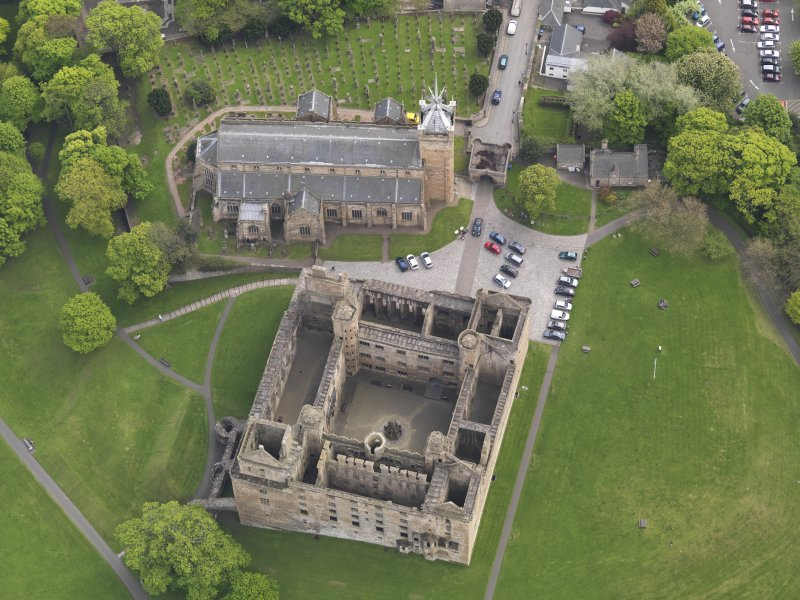 Oblique aerial view centred on the Palace with the parish church adjacent, taken from the NNW.