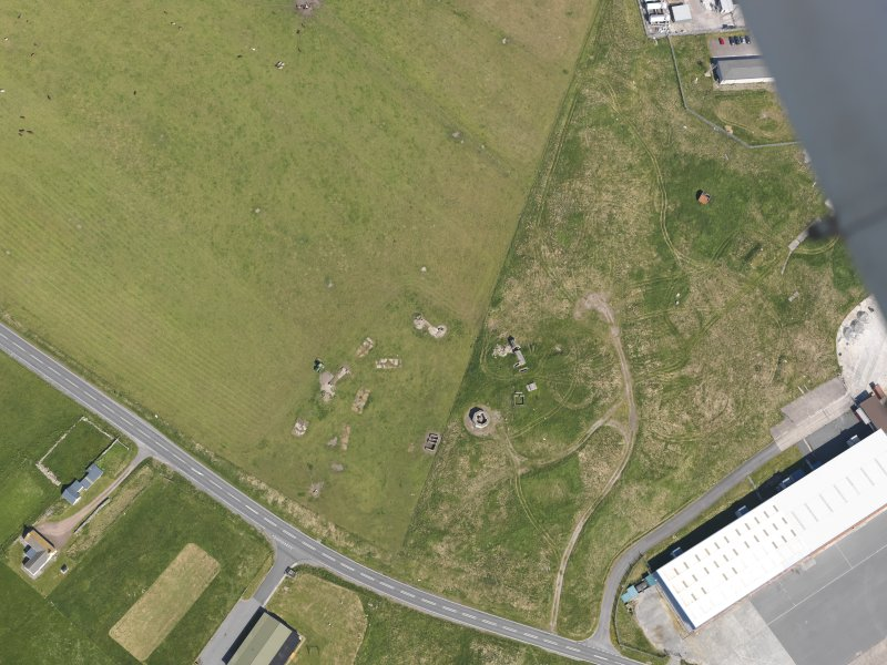 Oblique aerial view centred on the remains of the air raid shelters and military camp at Sumburgh, taken from the SSE.