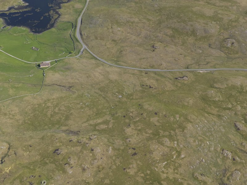 Oblique aerial view of Scord of Brouster, looking SE.