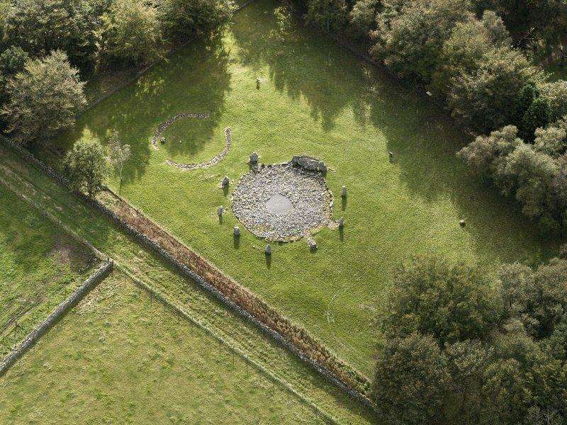 Oblique aerial view of the remains of the recumbent stone circle and enclosed cremation cemetery at Loanhead of Daviot, taken from the N.