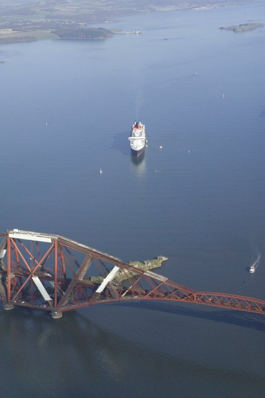 General oblique aerial view of the Queen Mary 2 with the Forth Rail Bridge in the foreground, taken from the WSW.