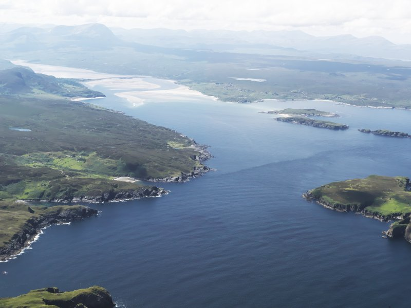 General oblique aerial view looking along the coast towards Tongue Bay and the Kyle of Tongue with Ben Hope beyond, taken from the ENE.