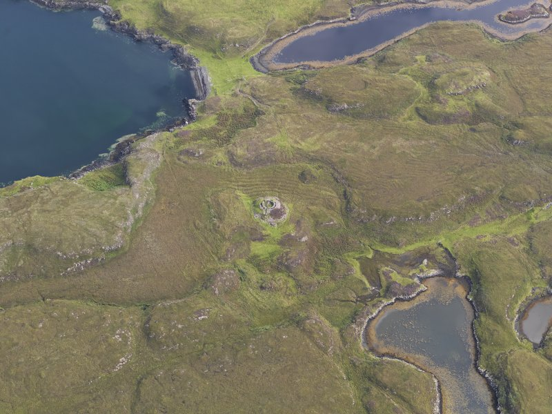 Oblique aerial view of Dun Fiadhairt, looking NE.