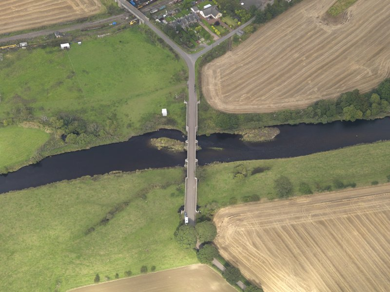 Oblique aerial view of Bridge of Dun, taken from the S.