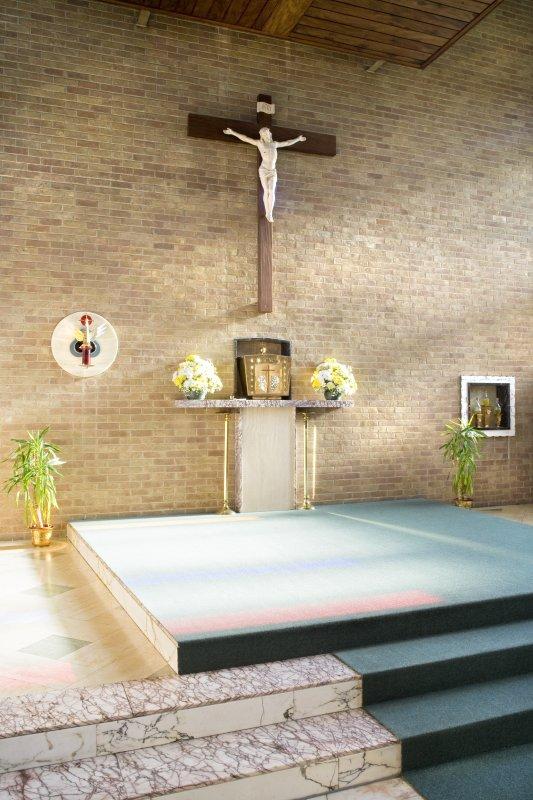 Interior. Crucifix and aumbry.