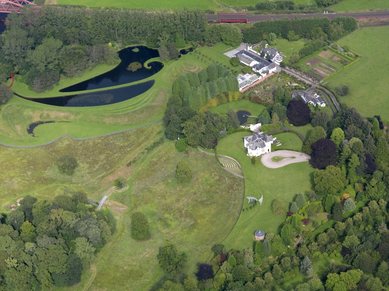 General oblique aerial view of Portrack House and gardens, taken from the SW.