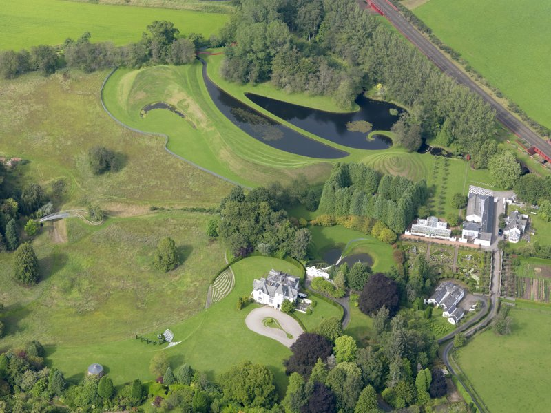 Oblique aerial view of Portrack House and gardens, taken from the SSW.