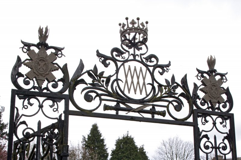 South gate leading to garden. Decorative ironwork.