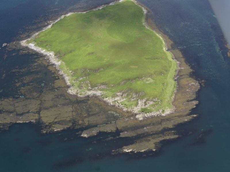Oblique aerial view of Am Fraoch Eilean and Claig Castle, looking N.