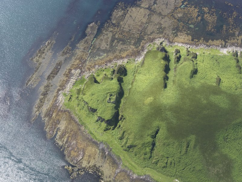 Oblique aerial view of Am Fraoch Eilean and Claig Castle, looking SW.