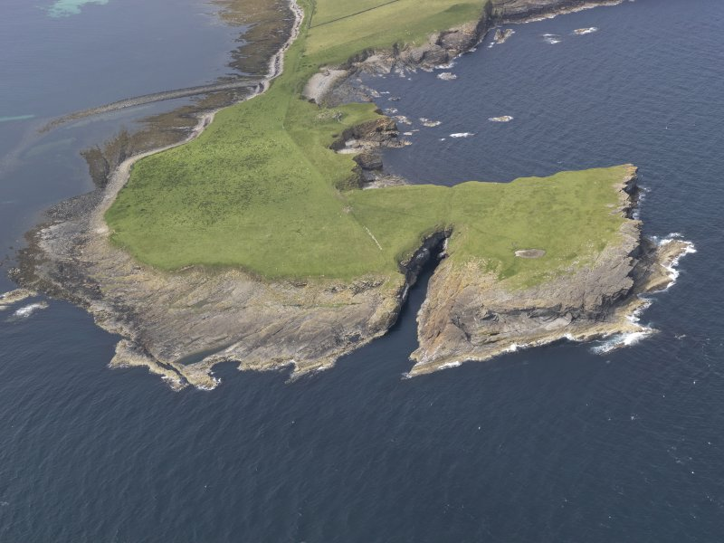 Oblique aerial view centred on Lamb Head, Stronsay, looking NNW.