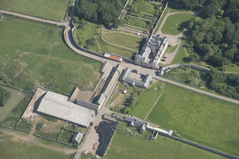 Oblique aerial view of Sandside House and Home Farm, looking to the SE.