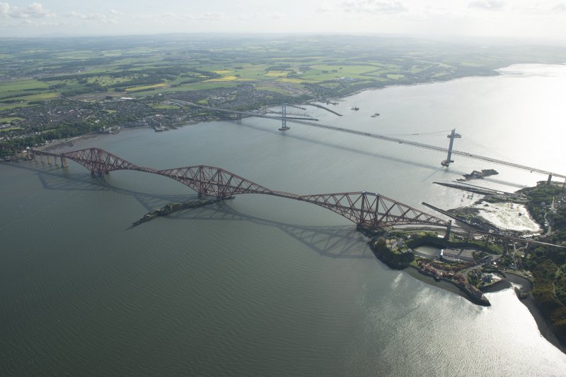 General oblique aerial view of the Forth Bridge, the Forth Road Bridge and the construction of the Queensferry Crossing, looking SW.