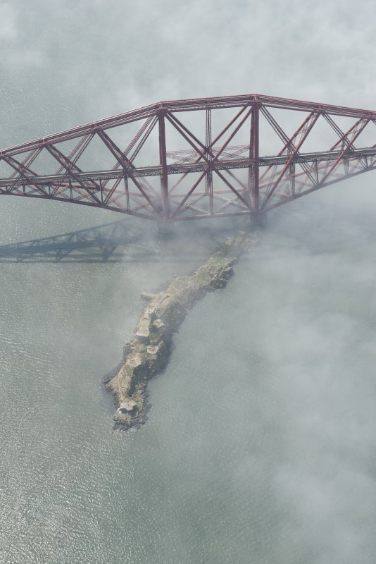 Oblique aerial view of the Forth Bridge centred on Inchgarvie, looking W.