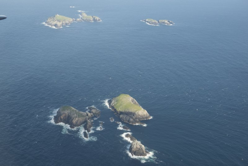 General oblique aerial view of Roaiream and Eilean a' Ghobha, Flannan Isles, with Eilean Mor and Soraigh beyond, looking to the ESE.