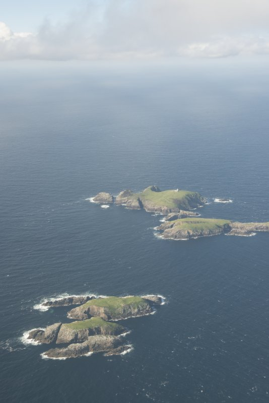 General oblique aerial view of Soraigh with Eilean Mor and Eilean Tighe beyond, looking to the N.