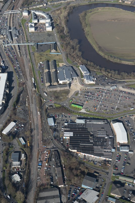 Oblique aerial view of The Barracks and Phoenix Industrial Estate, looking N.