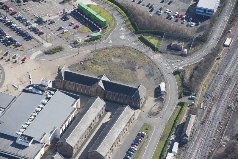 Oblique aerial view of The Barracks, looking SE.