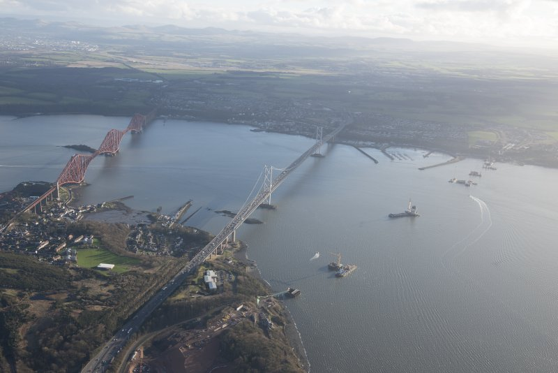 Oblique aerial view of the construction of the Queensferry Crossing, the Forth Road Bridge and Forth Rail Bridge, looking SSE.