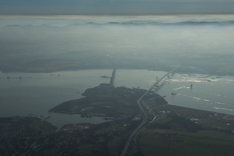General oblique aerial view of the Forth Bridge, Forth Road Bridge and Queensferry Crossing construction, looking to the S.