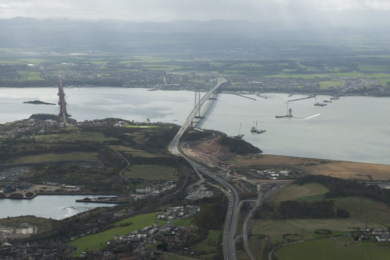 General oblique aerial view of the Forth Road Bridge, the Rail Bridge and the construction of the Queensferry Crossing, looking S.