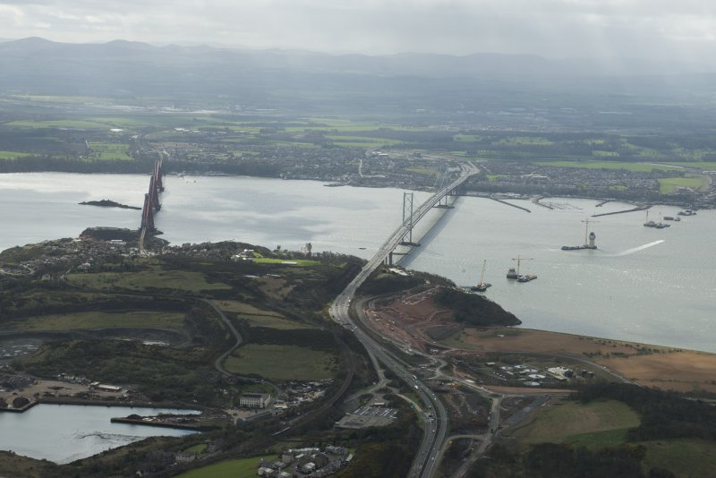 General oblique aerial view of the Forth Road Bridge, the Rail Bridge and the construction of the Queensferry Crossing, looking SSE.