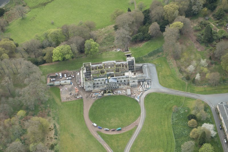 Oblique aerial view of Penicuik House, looking SW.