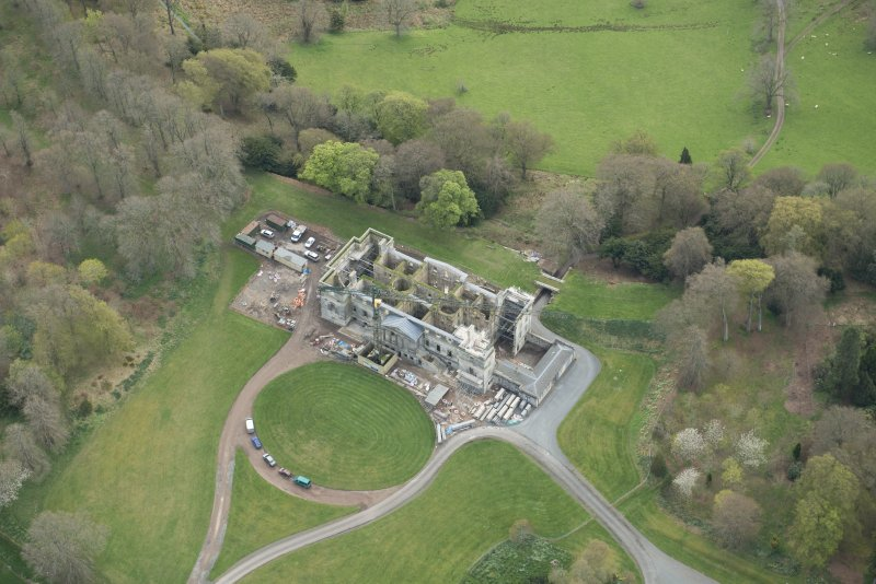 Oblique aerial view of Penicuik House, looking S.