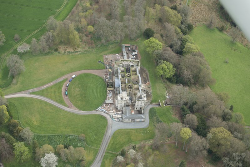 Oblique aerial view of Penicuik House, looking SE.