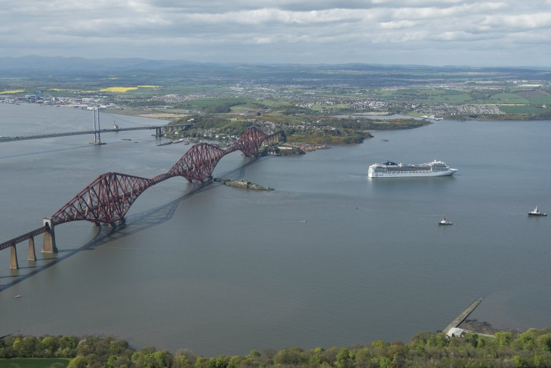 Oblique aerial view of the Forth Bridge and ship, the MSC Magnifica, looking WNW.