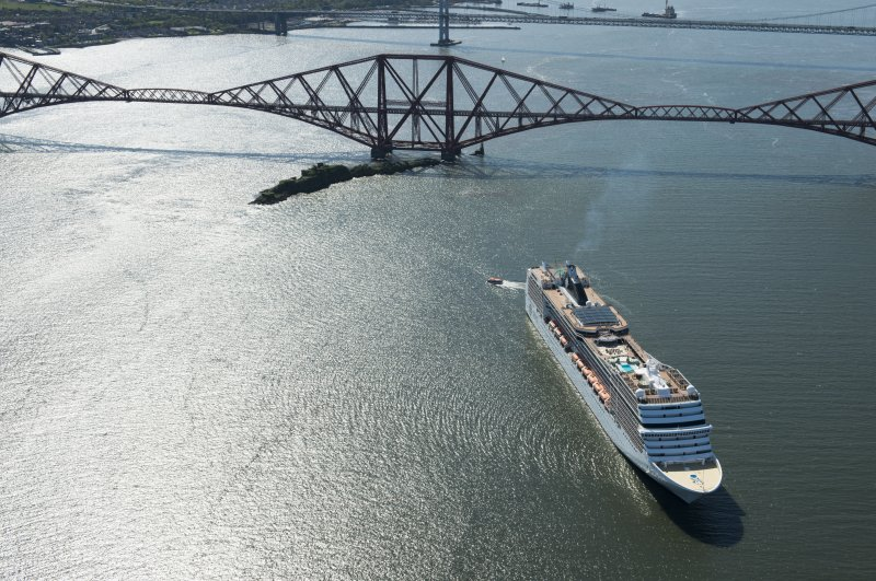 Oblique aerial view of the Forth Bridge and ship, the MSC Magnifica, looking WSW.