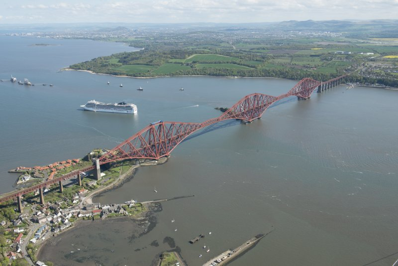 Oblique aerial view of the Forth Bridge and ship, the MSC Magnifica, looking W.