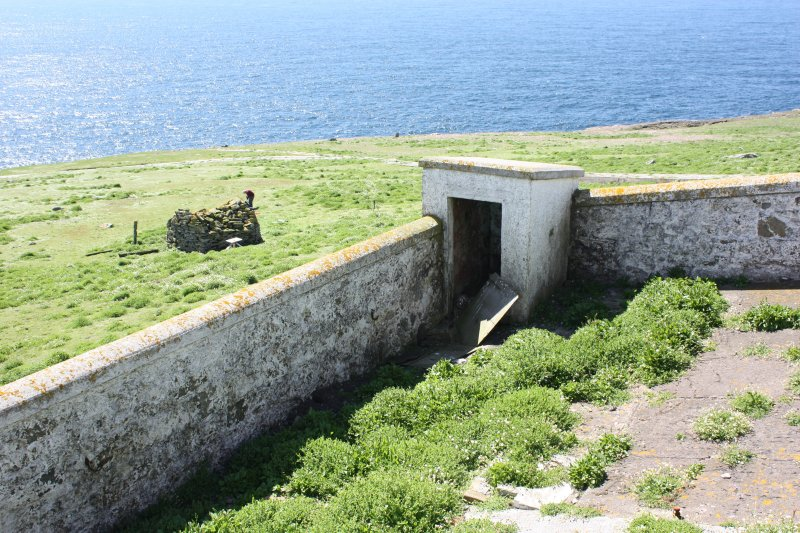 View over lighthouse enclosure and privy to chapel, facing SW.