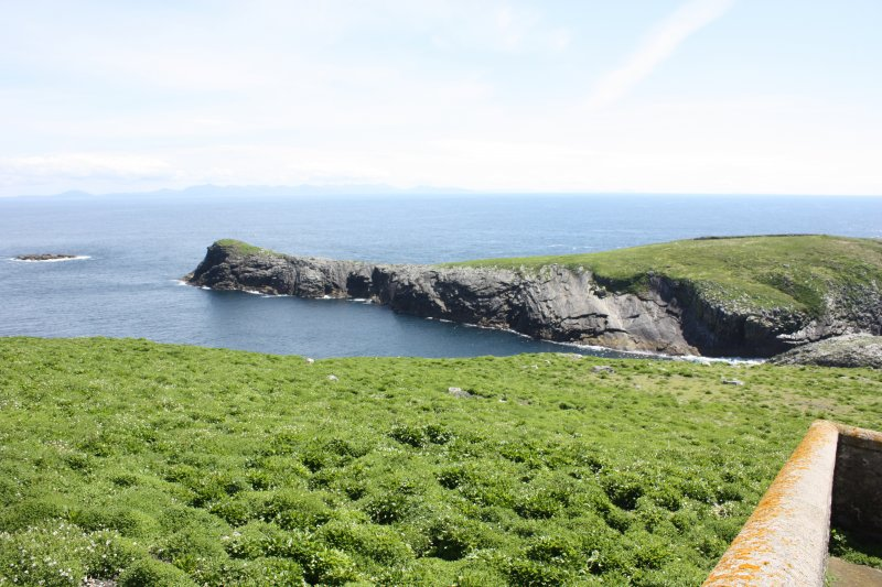 View over lighthouse enclosure to Eilean Tighe.
