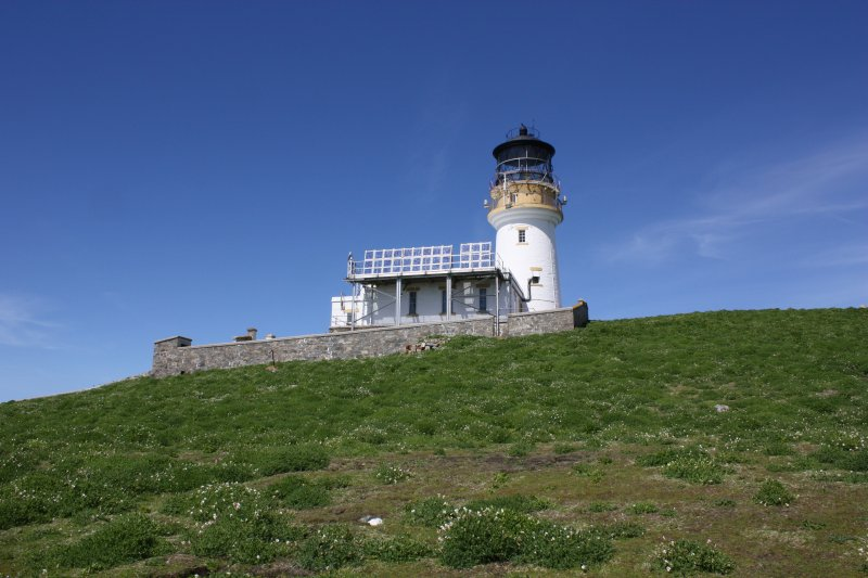 Flannan Isles lighthouse. General view from the south of the lighthouse and accommodation block, with later solar panels above.