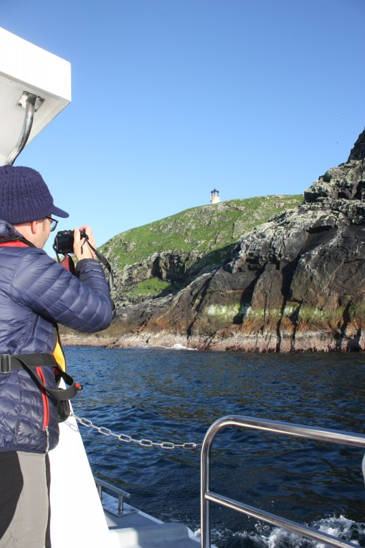 View of the north side of Eilean Mor, Mr Fraser Macdonald in shot.