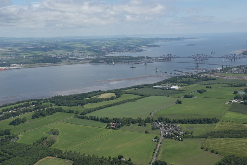 General oblique aerial view of the Upper Firth of Forth with The Queensferry Crossing construction, The Forth Road bridge and Forth bridge in the distance and the village of Newton in the foreground, looking NE.