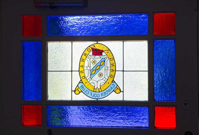 Ground floor. Entrance hall. Detail of stained glass in front door.