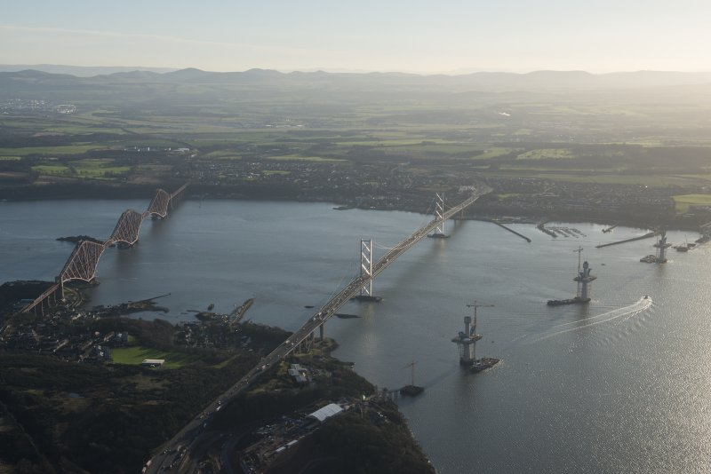 General oblique aerial view of the Forth Bridge, the Forth Road Bridge and the construction of the Queensferry Crossing, looking SSE.