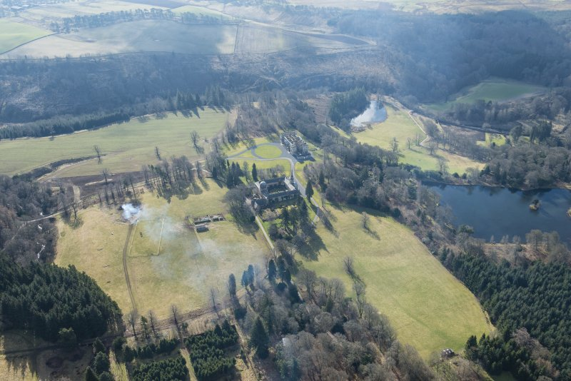 General oblique aerial view of the Penicuik House and stables, looking SW.