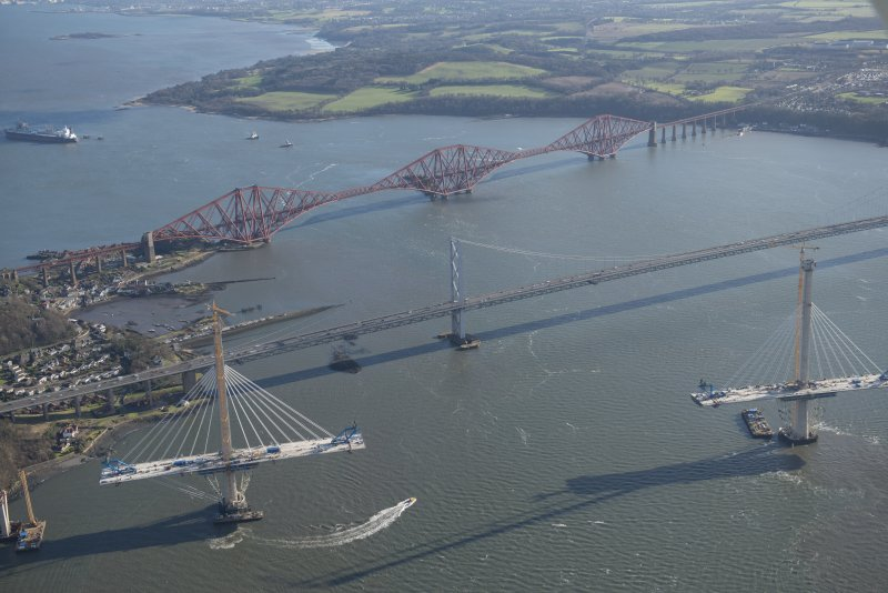 Oblique aerial view of the Forth Road Bridge, Forth Bridge and Queensferry Crossing, looking ESE.