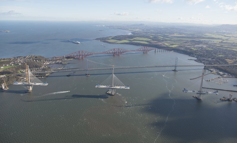 Oblique aerial view of the Forth Road Bridge, Forth Bridge and Queensferry Crossing, looking E.