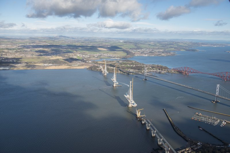 Oblique aerial view of the Forth Road Bridge, Forth Bridge and Queensferry Crossing, looking ENE.
