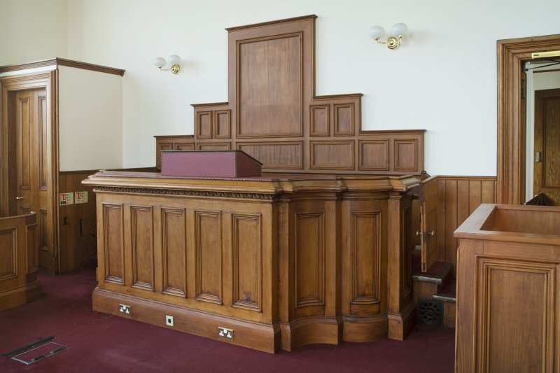 Interior. First floor. Detail of judges bench in courtroom.