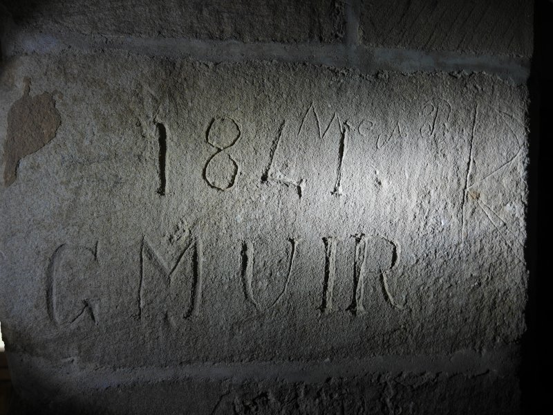 Historic graffiti on first floor of tower.