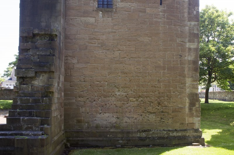 View of musket ball marks on north wall of tower.